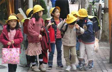 Tokyo children wearing yellow caps